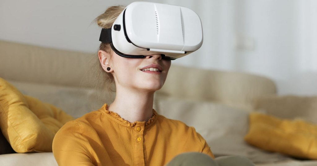 Charming Girl Experiencing Virtual Reality At Home